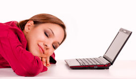 Tired girl with laptop Royalty Free Stock Photos