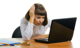 Tired girl in the office. Tired girl sitting in the office with the laptop Royalty Free Stock Photo