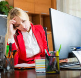 Tired girl in office Stock Photo