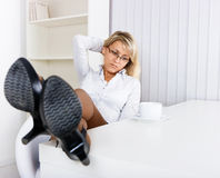 Tired girl in the office Stock Photos