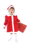 Tired girl in santa clothes Royalty Free Stock Images