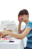 Tired Girl seamstress and sewing machine royalty free stock image