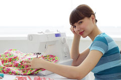 Tired girl seamstress and sewing machine Royalty Free Stock Images