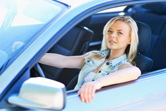 Tired girl sitting behind the wheel Royalty Free Stock Photo