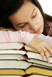 Tired girl sleeping on books stack Royalty Free Stock Image