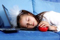 Tired girl sleeping at laptop Stock Photos