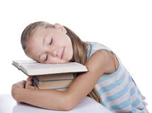 Tired girl slept. On the books Royalty Free Stock Image