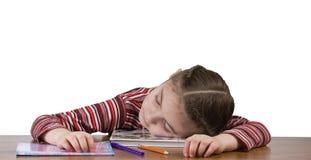 Tired girl slipping on books. Tired school girl felt into sleep during preparing homework isolated on white Stock Photos