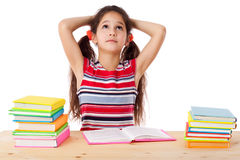 Tired girl with stack of books Royalty Free Stock Photo