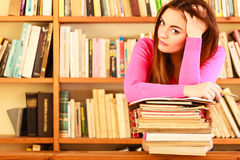 Tired girl student in college library Stock Photo