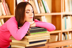 Tired girl student in college library. Education school concept. Tired female student fashion long hair girl in college library Stock Photos