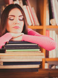 Tired girl student in college library. Education school concept. Tired female student fashion long hair girl in college library Stock Image