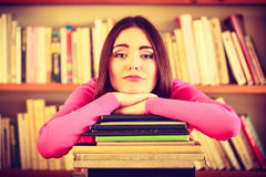 Tired girl student in college library Royalty Free Stock Photos