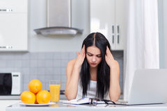 Tired girl thinking about exercise of home task. Royalty Free Stock Photo