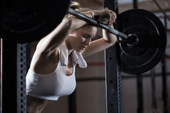 Tired girl after weight lifting Stock Images