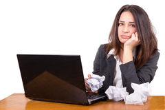 Tired girl working on a laptop Royalty Free Stock Images