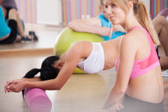Tired girls after pilates training Stock Photo