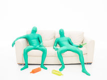 Tired green faceless men Stock Photos