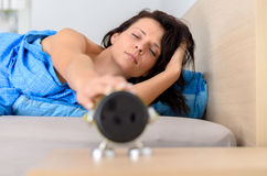 Tired groggy young woman waking up royalty free stock photos