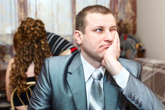 Tired groom waiting a bride Stock Photography