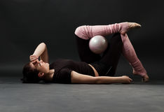 Tired gymnast with ball Royalty Free Stock Photos