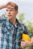Tired handyman. Royalty Free Stock Image