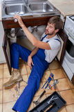 Tired handyman at work Stock Photography