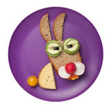 Tired hare made of bread and vegetables Royalty Free Stock Image
