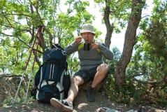 Tired hiker eats Stock Photos