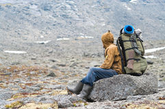 Tired hiker in mountain Stock Photos