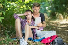 Tired hiking couple in forest. Couple stock image