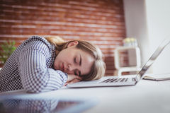 Tired hipster businesswoman sleeping Royalty Free Stock Photos