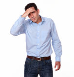 Tired hispanic guy with headache standing Royalty Free Stock Photography