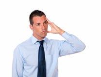 Tired hispanic man with head pain Stock Photo