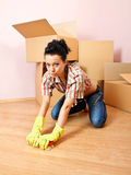 Tired housewife. Tired young woman with yellow rubber gloves scrubs the floor Stock Photos