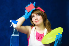 Tired housewife cleaning the dishes Stock Images