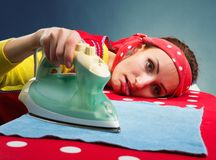 Tired housewife with  ironing-board Royalty Free Stock Image