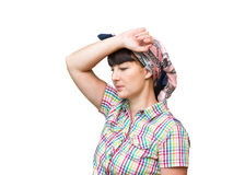 Tired housewife keeps his hand near his head. Royalty Free Stock Photography