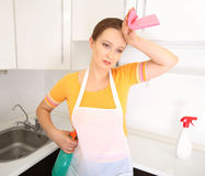 Tired housewife in kitchen Stock Photo