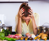 Tired housewife at kitchen Stock Images