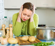 Tired housewife at kitchen Stock Photo