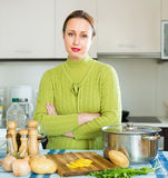 Tired housewife at kitchen Stock Photos