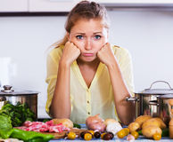 Tired housewife at kitchen Royalty Free Stock Images