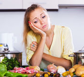 Tired housewife at kitchen Royalty Free Stock Photo