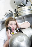 Tired housewife and pile of dirty dishes Stock Images