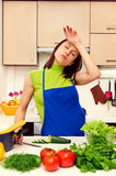 Tired housewife preparing dinner Stock Photos