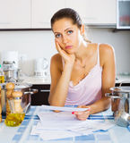 Tired housewife reading bills Stock Image