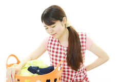 Tired housewife. The woman is holding a Laundry basket Royalty Free Stock Photography