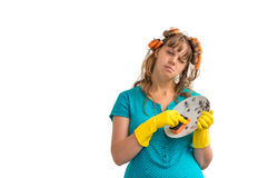 Tired housewife woman washing dishes Royalty Free Stock Image