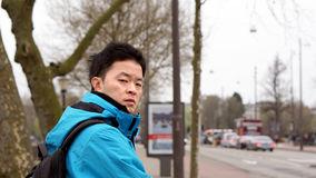 Tired, jet lag Asian man after traveling to Europe Royalty Free Stock Photos